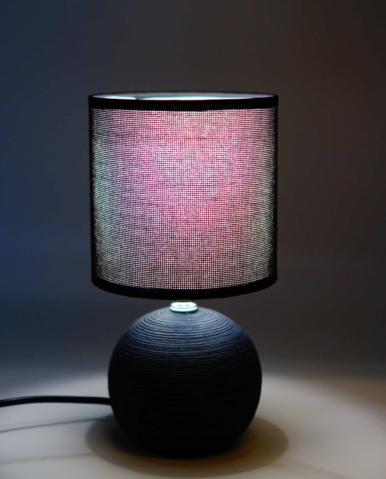 A table lamp of black round ceramic base