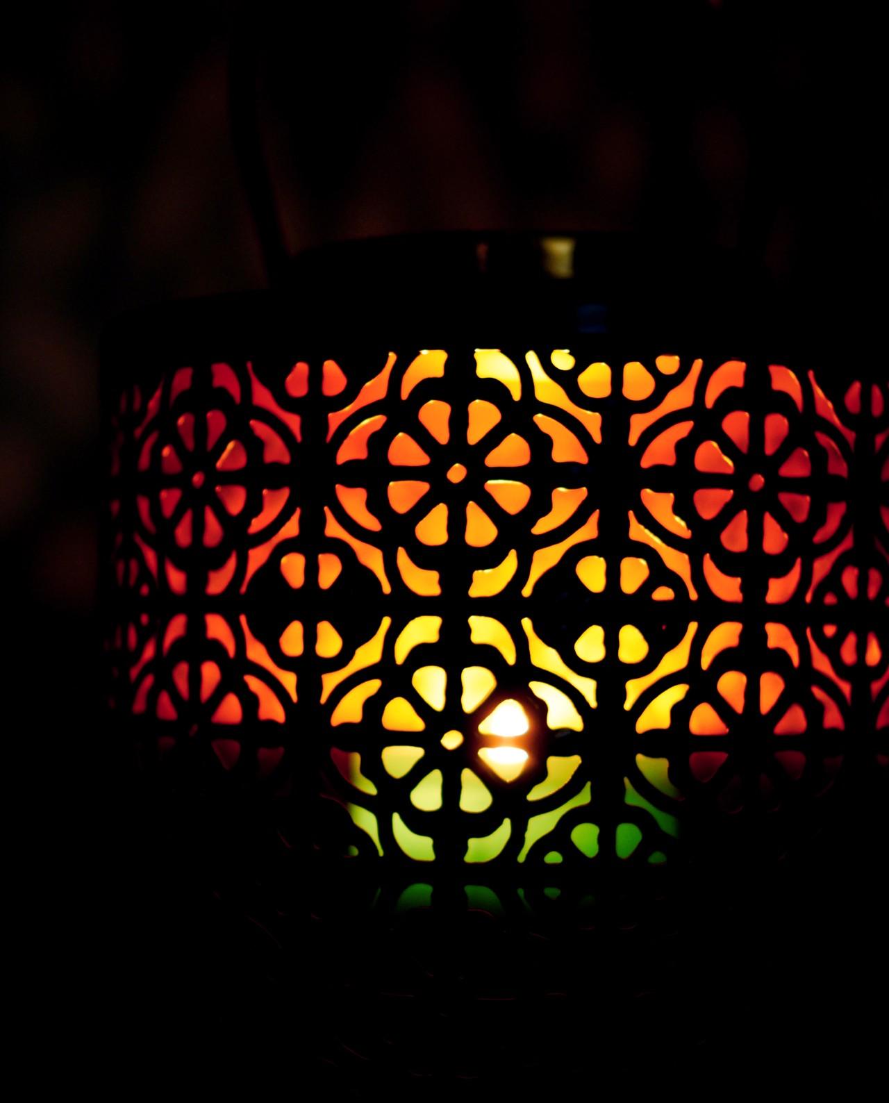 Lantern made of metal in light pastel green color