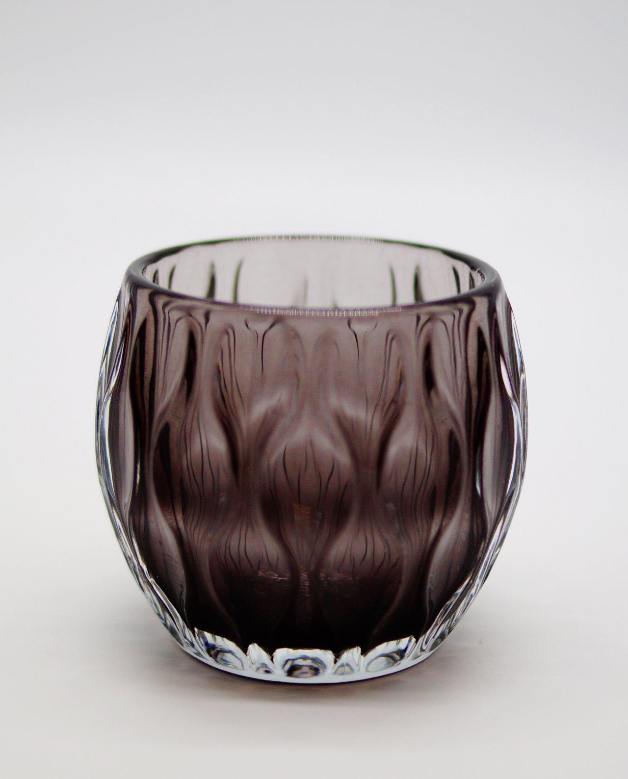 Votive of heavy tealight purple glass