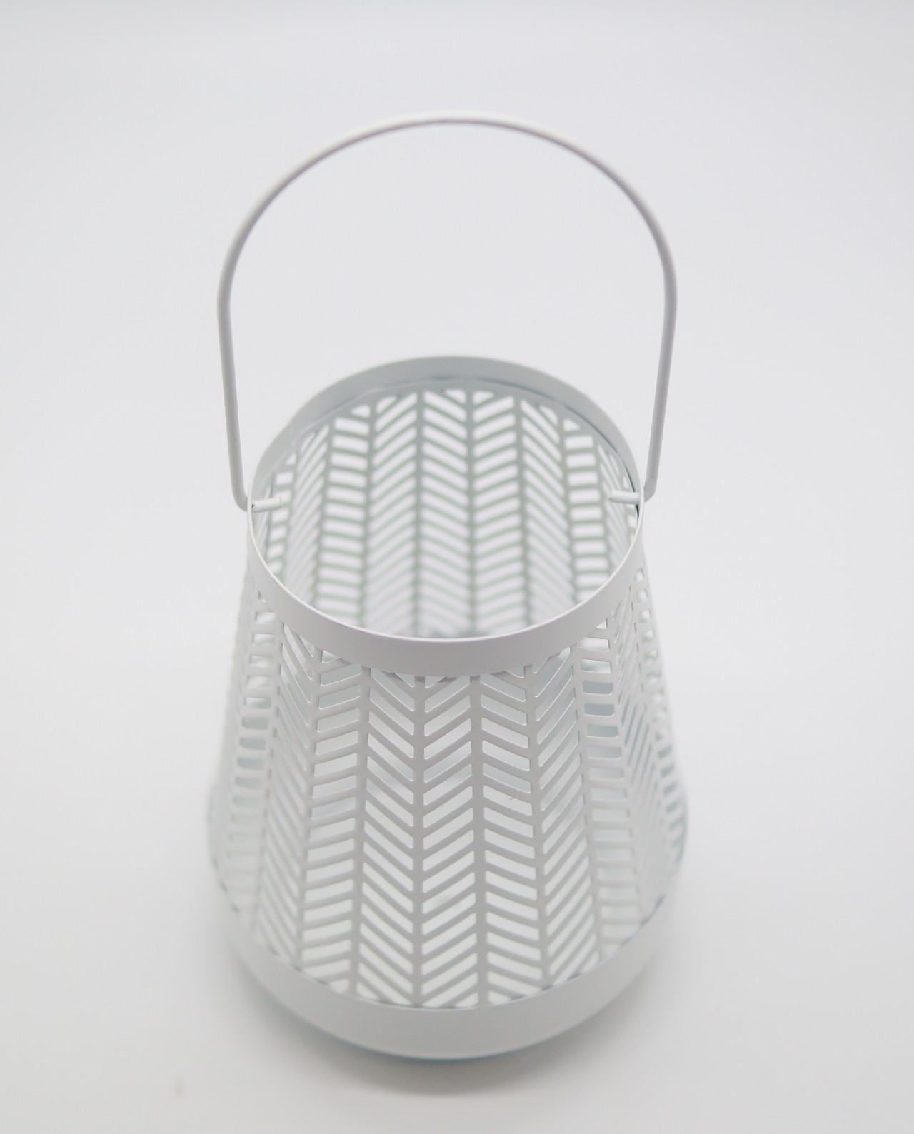 Lantern made of metal in bright white color