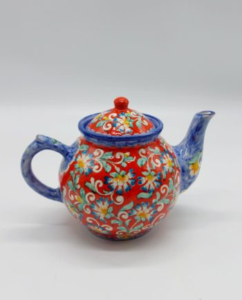 A handmade ceramic teapot, hand painted with the best of art originating from Persia.